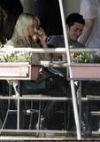 a distracted Jessica Simpson dining with friends